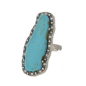 """Burnished silver tone adjustable ring featuring a turquoise stone, accented by clear rhinestones. Stone measures approximately 2"""" in length."""