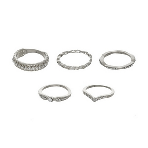 Five piece silver tone ring set with clear rhinestones. All rings are one size and not adjustable. Approximately size 7.