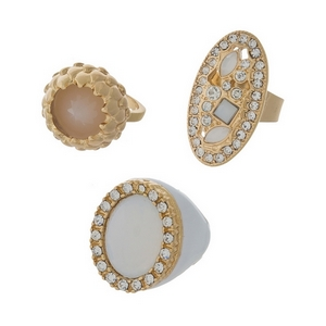 Three piece gold tone ring set featuring white stones. All rings approximately a size 7.