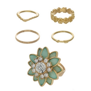 Gold tone five piece ring set featuring a mint green stone flower ring and small knuckle rings. Assorted sizes from 4 to 7.