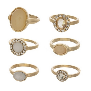 Gold tone, six piece ring set featuring opal and ivory stones. All rings are one size and not adjustable. Approximately a size 7.