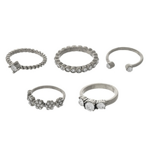 Silver tone, five piece ring set. All rings are one size, approximately a size 7.