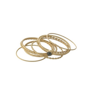 Dainty, gold tone, ten piece knuckle ring set. All ten rings are approximately a size 7 and cannot be adjusted.