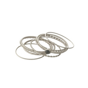 Dainty, silver tone, ten piece knuckle ring set. All ten rings are approximately a size 7 and cannot be adjusted.