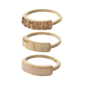 Gold tone, three piece ring set with peach rhinestones. All three rings are approximately a size 6 and cannot be adjusted.