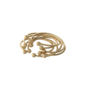 Dainty seven piece, gold tone cuff ring set. All rings can be adjusted.
