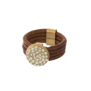 Brown genuine leather ring with clear pave rhinestones. Ring is a size 7.