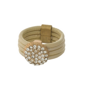 Ivory genuine leather ring with clear pave rhinestones. Ring is a size 7.