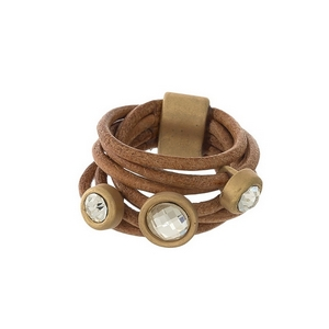 Brown genuine leather ring with clear rhinestones. Ring is a size 7.