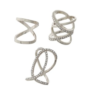 Three piece silver tone ring set with a criss-cross pattern and clear rhinestones. All three rings are approximately a size 7 and are not adjustable.
