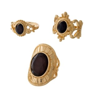 Three piece gold tone ring set with black stones. All three rings are approximately a size 7 and are not adjustable.