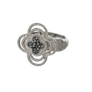 Silver tone stretch ring with a clover focal, accented with crush hematite stones.