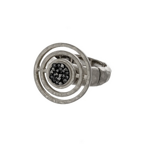 Silver tone stretch ring with a circle focal, accented with crush hematite stones.