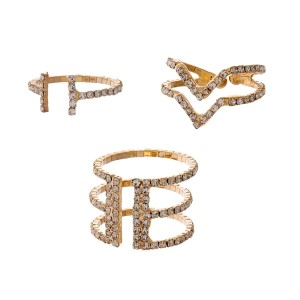 Gold tone, flexible ring set with clear rhinestones. Each ring flexes to fit most sizes.
