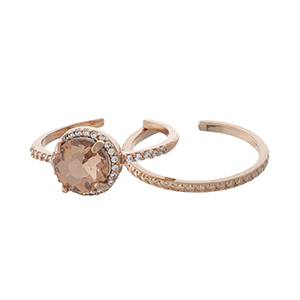 Rose gold tone, two piece stackable ring set with a clear, circle rhinestone.