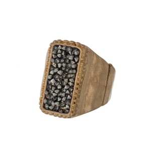 Burnished metal stretch ring with a crushed hematite rectangle.