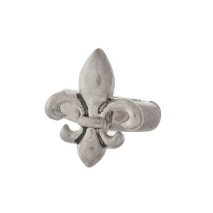 Burnished metal stretch ring with a Fleur de Lis focal.
