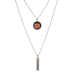 "Officially licensed Auburn University double layer silver tone necklace with a logo pendant and a ""Tigers"" stamped bar pendant. Approximately 16"" in length."
