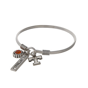 Officially licensed University of Tennessee silver tone bracelet with an orange rhinestone, logo, and Volunteers stamped bar charm.