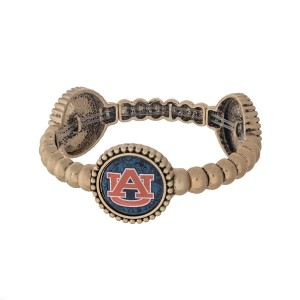 Officially licensed gold tone Auburn University stretch bracelet with three stations. Our own exclusive design.