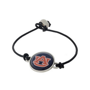*Our Exclusive Design* Officially licensed Auburn University, genuine leather cord bracelet with a freshwater pearl bead closure.