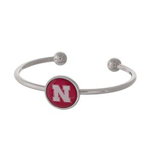 Officially licensed, silver tone cuff bracelet with the University of Nebraska logo.