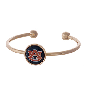 Officially licensed, rose gold tone cuff bracelet with the Auburn University logo.