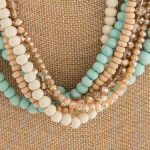 Wholesale layered necklace wood iridescent beaded details