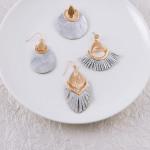 Wholesale faux leather teardrop inspired earrings metallic snakeskin details gol